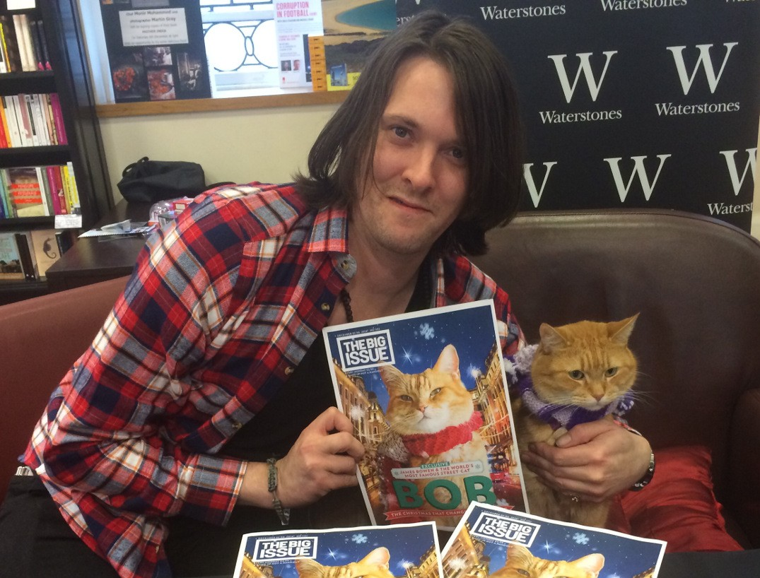 James and Street Cat Bob with their Christmas Big Issue cover