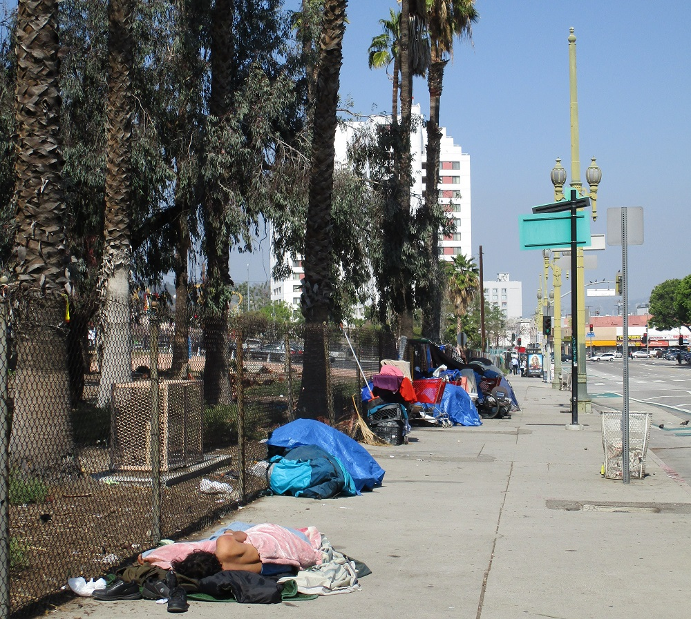 Homeless people sleeping just a few blocks away from the press conference. Photo: Bud Stratford