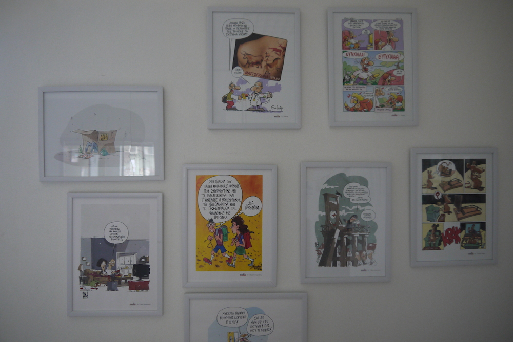 Artworks from the Shedia street paper adorn the walls at the Shedia office. Photo by Alison Gilchrist