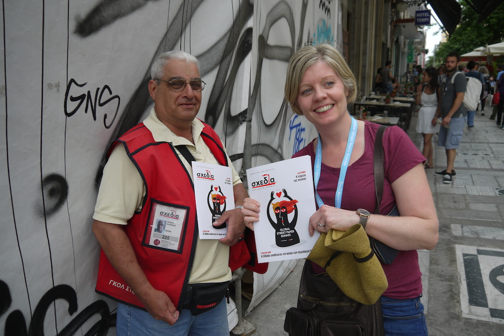 Emma O'Halloran from the Big Issue Australia buys a copy of Shedia from a local vendor. Photo by Alison Gilchrist