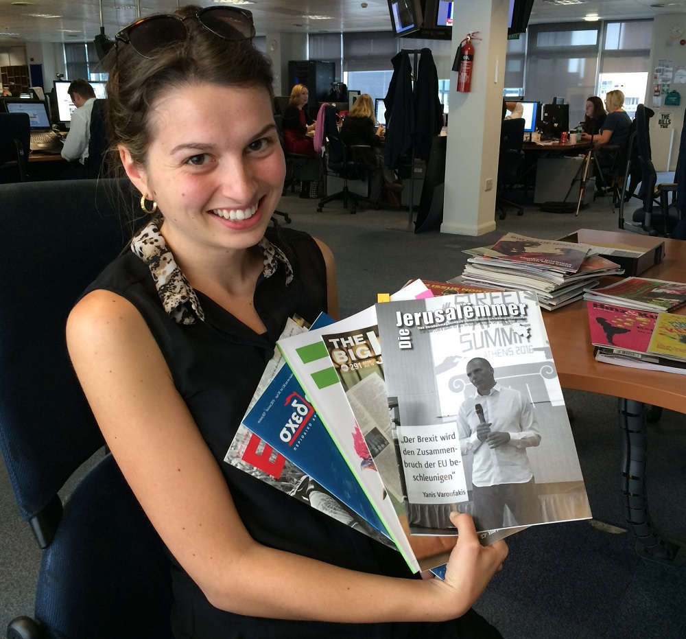 Francesca checks out a selection of international street papers.