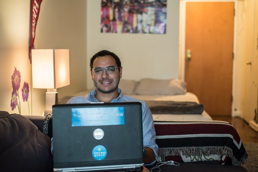 Harvard grad and D.C. entrepreneur Amr Arafa in his apartment, where he has hosted several guests in distress until they could get back on their feet. Photo: Benjamin Burgess