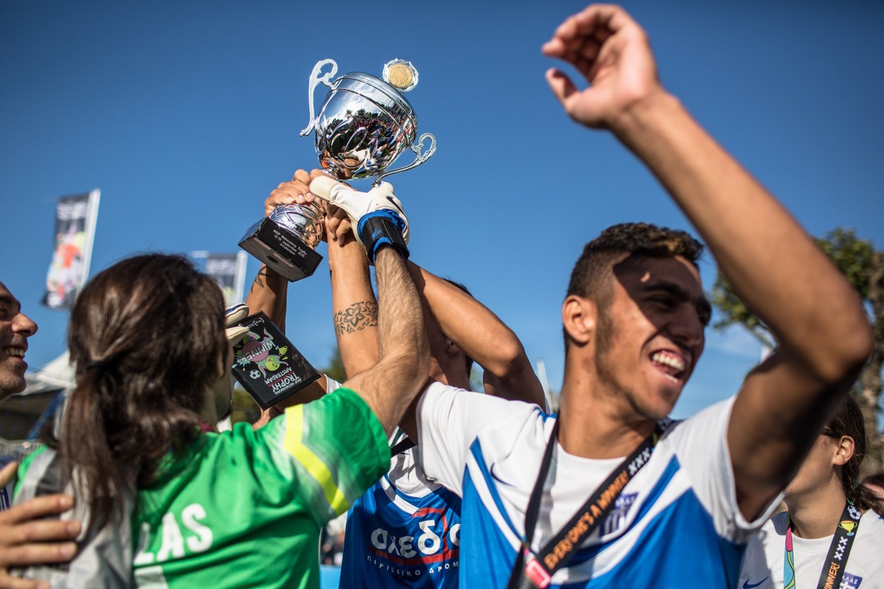 Greece lift the INSP Trophy at the Homeless World Cup in Amsterdam. Photo: Alex Walker