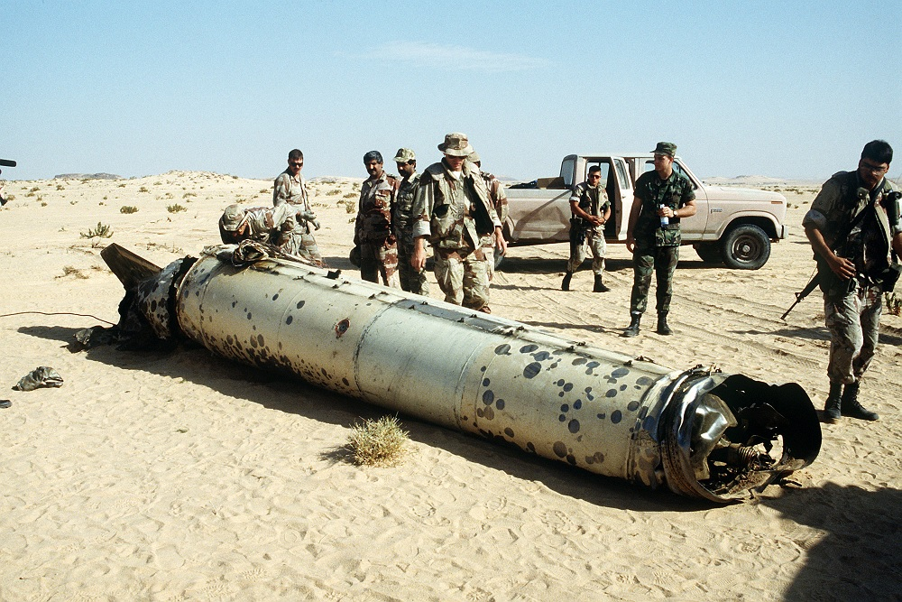 Military personnel examine the remains of a Scud during the Persian Gulf War.