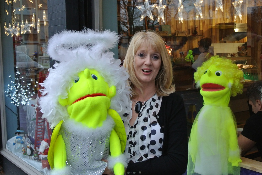 Gail, with the cafe's Christmas puppets that they use in shows for children