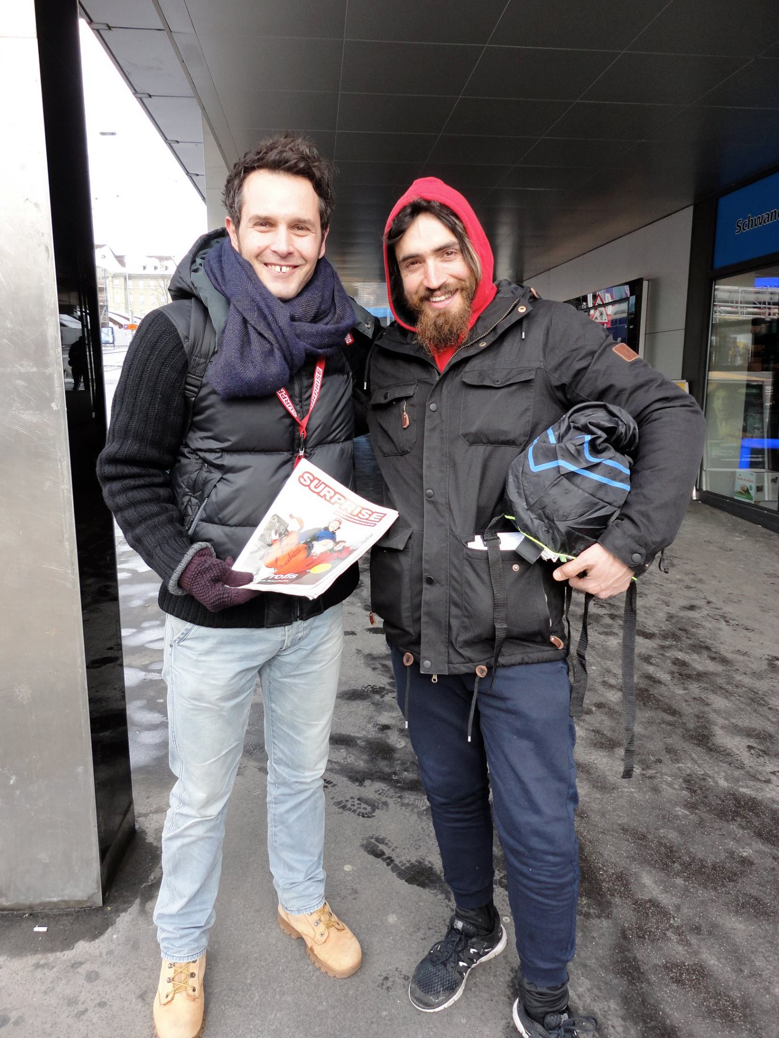 Surprise reader Marco (L) tries his hand at selling a street paper in Bern, 2015.