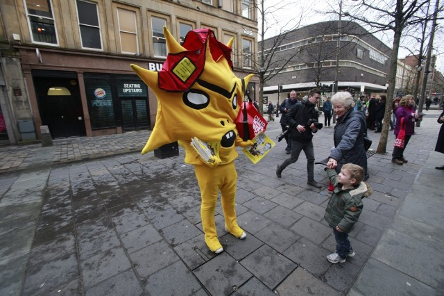 Kingslet attempts to make a sale to a young passerby. Photo: Herald and Times<br>