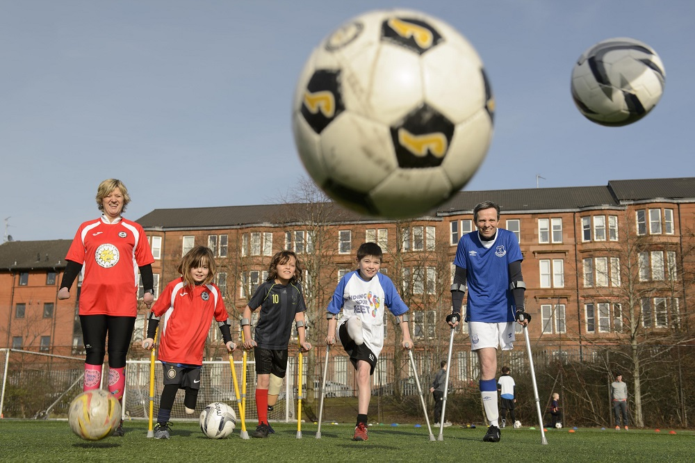 Corrine Hutton (far left) with Keeley Ceretti (2nd left) and Brian Murray (far right) at an amputee football taster session hosted by Finding Your Feet and Partick Thistle in Glasgow, Scotland. Credit: John Linton