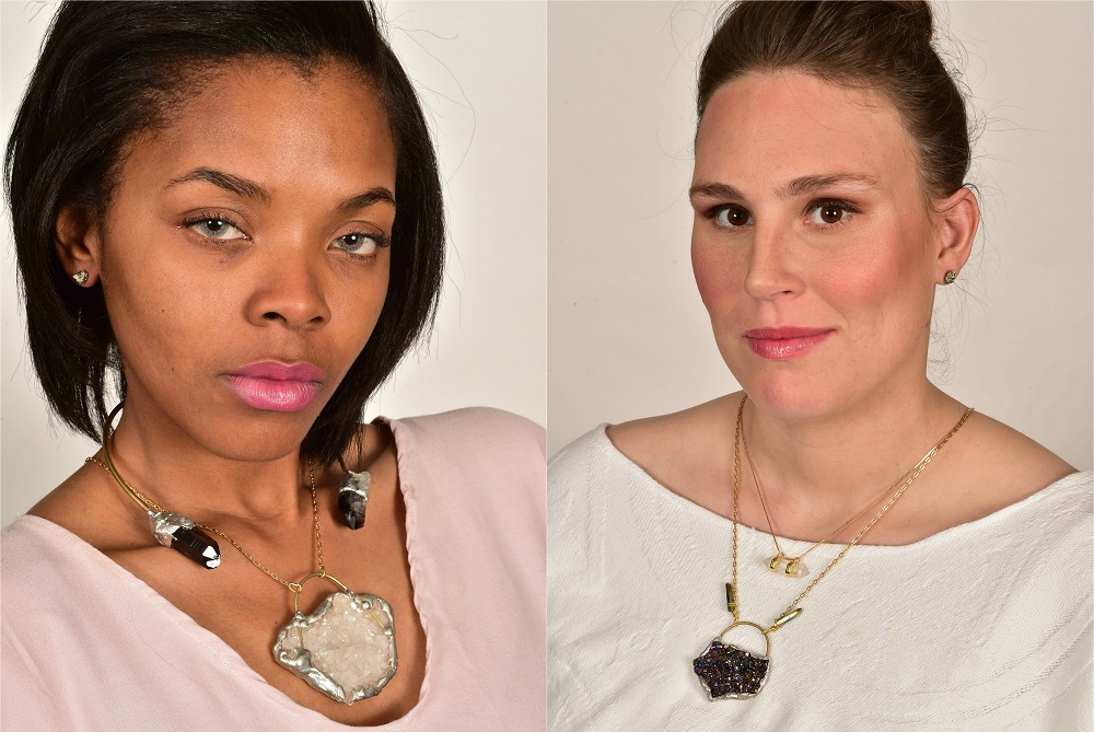 Curbside vendors Darnesha (R) and Tia (L) model jewellery for their street paper. Hair by Morgan Taylor Stoll and makeup by Samantha McLoud (Brushed Salon and Makeup Studio). Photo Shannon Cornman