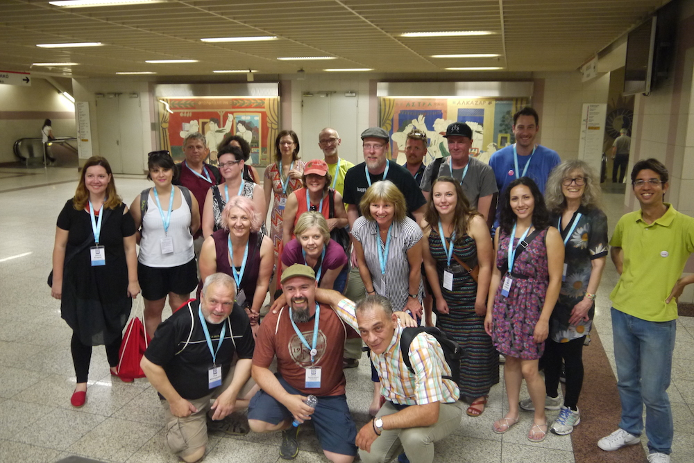 Delegates visit the Shedia offices to start an Invisible City Tour run by Shedia vendors. Photo by Alison Gilchrist
