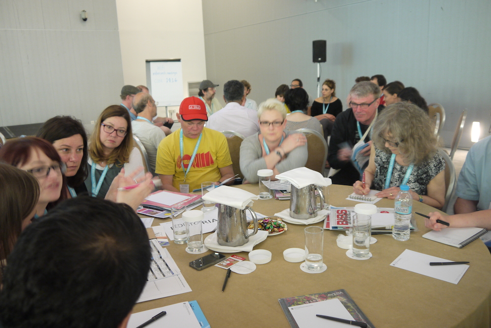 Delegates at round table on first day of summit. Photo by Alison Gilchrist