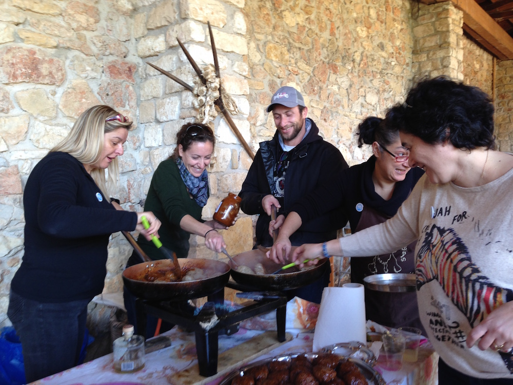 Shedia vendors receive a free meal from Wise Greece.