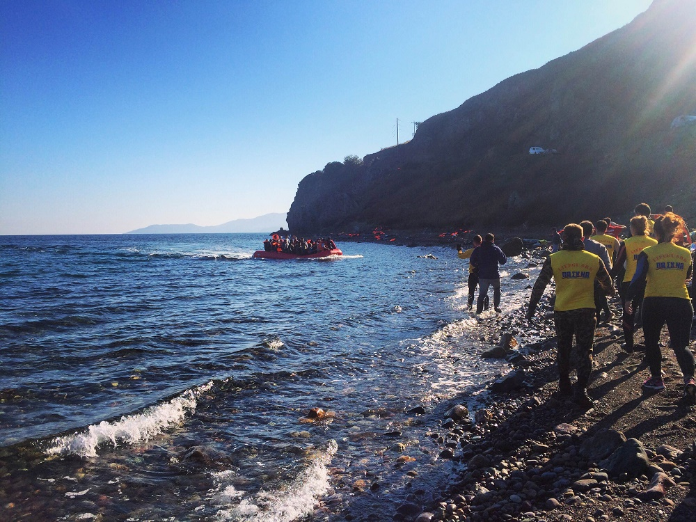 Refugees arrive on a beach in Lesvos. Credit: Colleen Skinsky/Street Roots