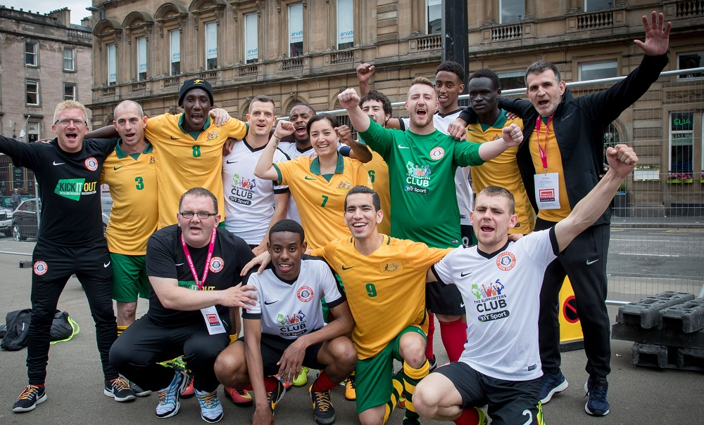 Teams from Australia and England celebrate after their match. Credit: The Homeless World Cup