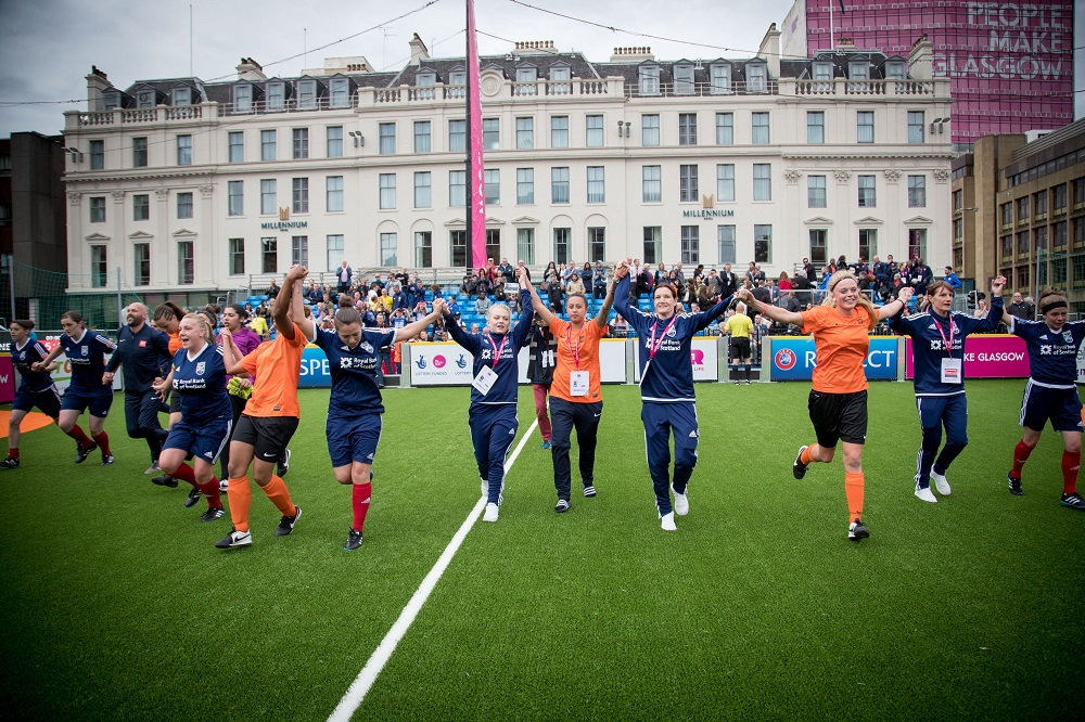 The Scotland and Netherlands women's team celebrate another exciting match. Photo: Homeless World Cup/Anita Milas
