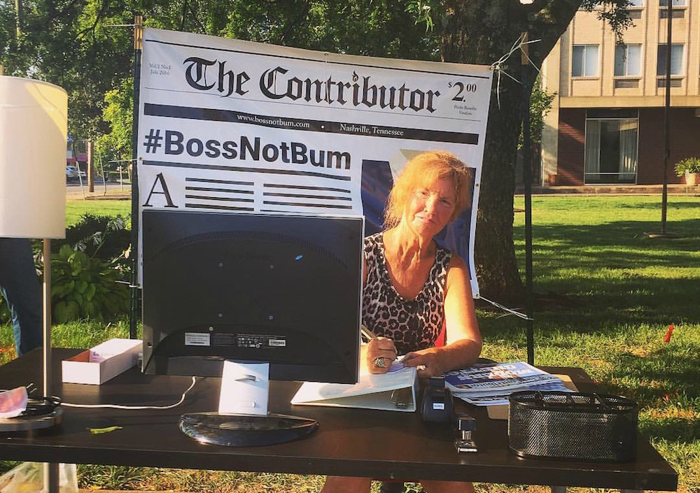 Vendor Sharon H is a microbusiness owner. She sits by a desk in Nashville as part of the #bossnotbum campaign. Credit: The Contributor