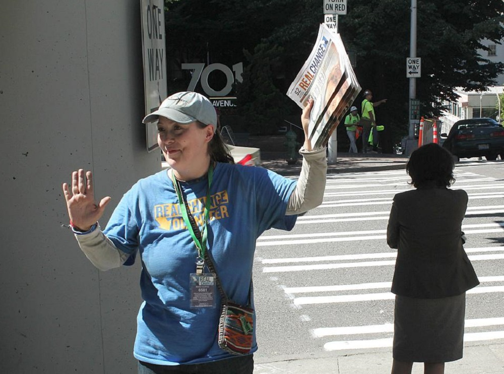Real Change' vendors Mellie Kaufman pictured. The Seattle-based street has made a passionate call-to-arms to its readers and supporters to join them in protesting against hate, against the backdrop of Donald Trump's first days as U.S. president.