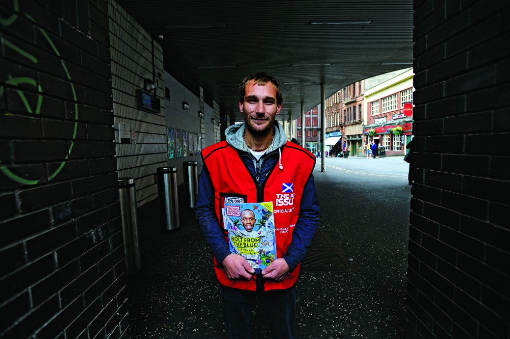 The Big Issue UK vendor Serban sells the magazine in Glasgow. Photo: Andy Buchanan