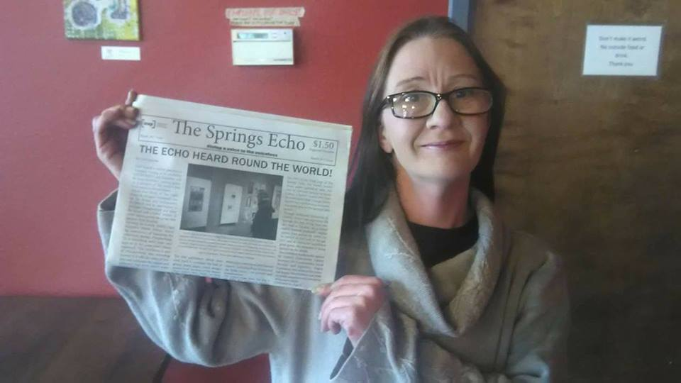 Raven pictured with issue 2 of The Springs Echo. Credit: Facebook