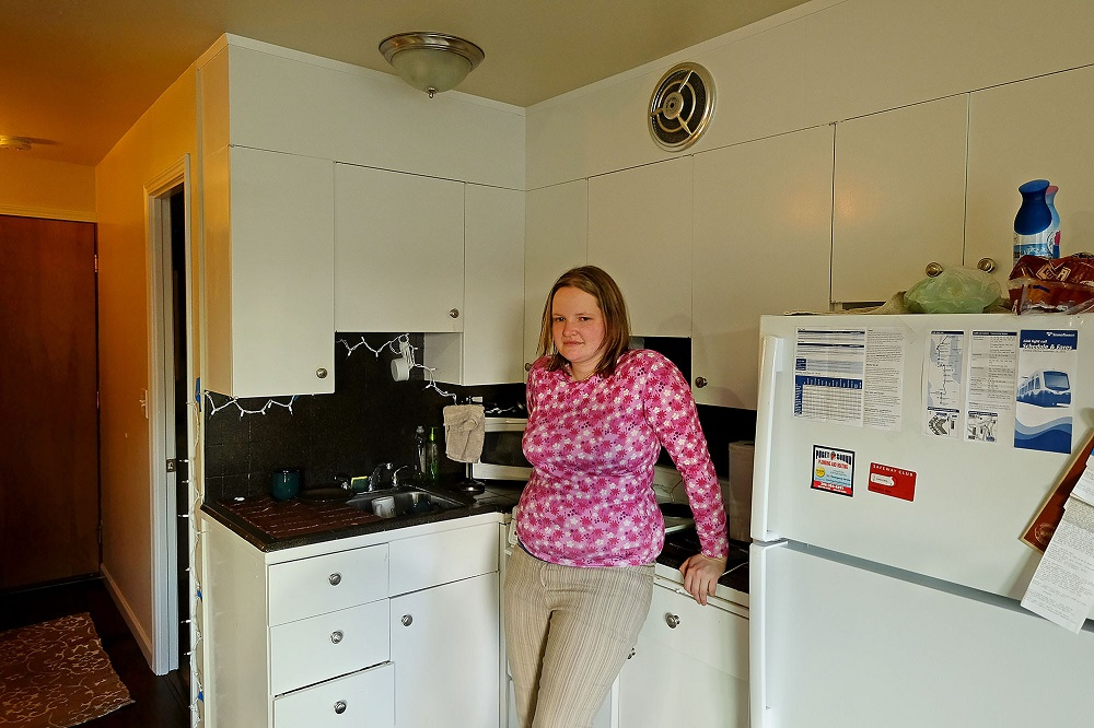 Lisa Sawyer in her apartment in Seattle's Greenwood neighborhood, Thursday March 16, 2017. Photo: Real Change