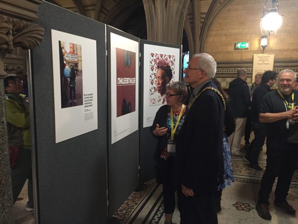Fay Selvan and Lord Mayor Eddy Newman view the UNCOVERED street paper art exhibition
