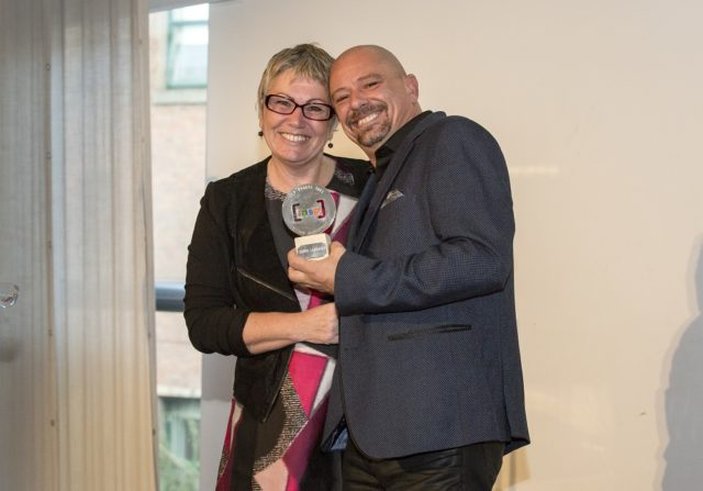 Serge Lareault receiving his award with Fay Selvan, INSP Chair. Photo by Rebecca Lupton.