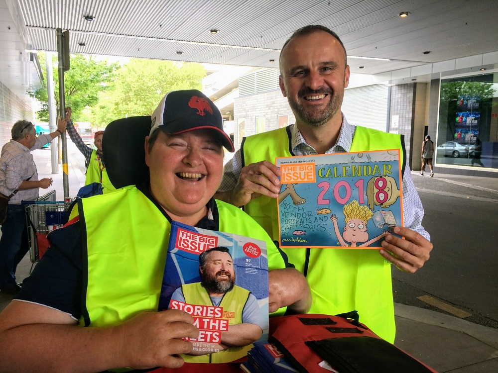 ACT Chief Minister Andrew Barr with Big Issue vendor Kylie in Canberra