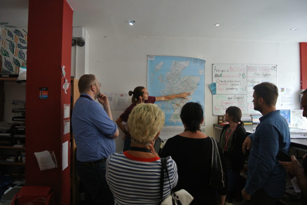 The Big Issue's distribution team leader for Scotland explains to German language delegates about vendor pitches
