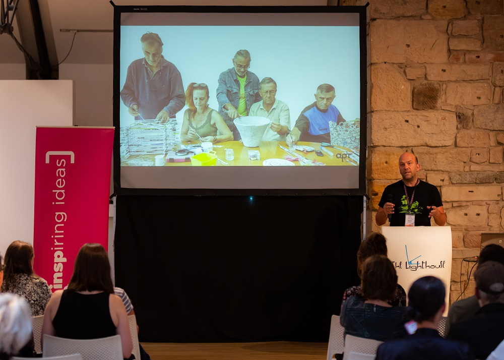 Chris Alefantis speaking at the INSP Talks about Shedia's upcycling project, Shediart. Credit: Jack Donaghy