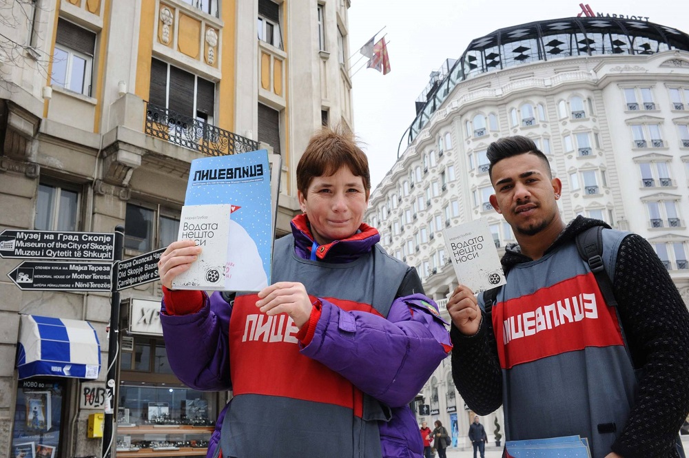 Lice v Lice vendors with the current issue of the street paper and the poetry book