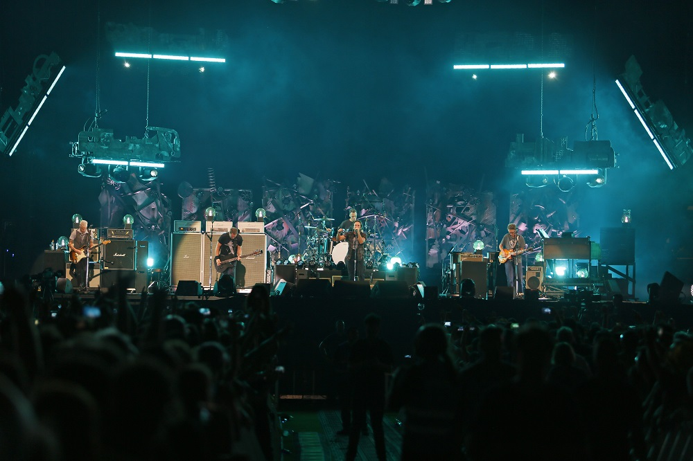 Gossard (far right) performs with Pearl Jam. (Photo credit: Matthew S. Browning)