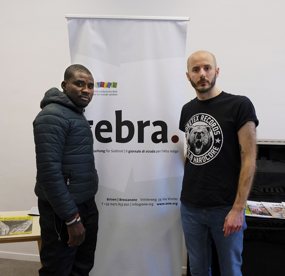 zebra. staff member Alessio Giordano (right) with zebra. vendor Geoffrey Onodu. (Credit: Anna Mayr)