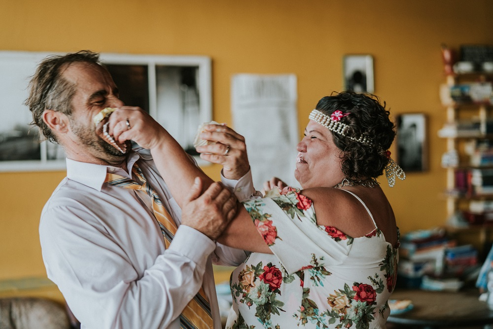 After cutting their cupcakes, Mark and Rene have a little fun with a cake smash. The pair started working with The Curbside Chronicle in 2018. (Credit: Ben Birdwell)